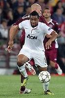 Gabriel Muresan (backward) of CFR Cluj challenges Anderson (in front) of Manchester United during the UEFA Champions League, Group H, soccer match at Dr. Constantin Radulescu Stadium in Cluj-Napoca, Romania, 2 October 2012.