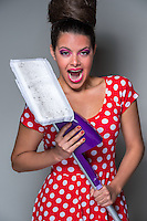 Funny retro housewife with a modern mop