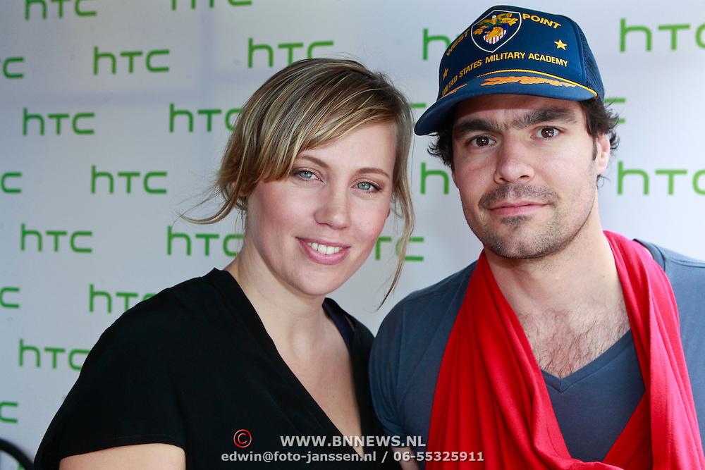 NLD/Amsterdam/20110904 - Grazia PC Catwalk 2011, Regina Romeijn en partner Erdem met baby Bardot