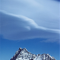 A lenticular cloud hovers over seemingly-conjoined Middle Palisade and Clyde Peak in the Palisade Crest region of California's Sierra Nevada.