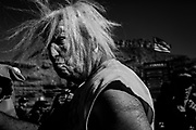 Red Bull Rampage 2017. Heavy metal is played high and loud and the spectators is having a party. Many are dressed up. Here a spectator wearing a mask looking like Mr. Trump.