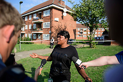 © Licensed to London News Pictures. 15/09/2016. London, UK. Fefe Selo, the cousin of the deceased, talks to media at scene of a double shooting in a block of flats in East Finchley. Police were called by London Ambulance Service at 06:25hrs this morning to reports of two people injured at an address in north London. A man and a woman were found with gunshot injuries. Both were pronounced dead at the scene. Photo credit: Ben Cawthra/LNP