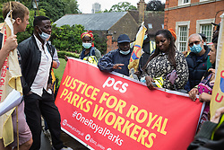 Royal Parks workers outsourced via French multinational VINCI Facilities hold a strike meeting during a picket outside the Old Police House in Hyde Park as part of joint strike action by the United Voices of the World (UVW) and Public and Commercial Services (PCS) trade unions on 30th July 2021 in London, United Kingdom. The joint strike, with members dual carding over pay, conditions and the sacking of a member of staff, is believed to be the first between a TUC and a non-TUC trade union and follows the launch of a legal challenge by the Royal Parks workers against indirect racial discrimination by the Royal Parks.