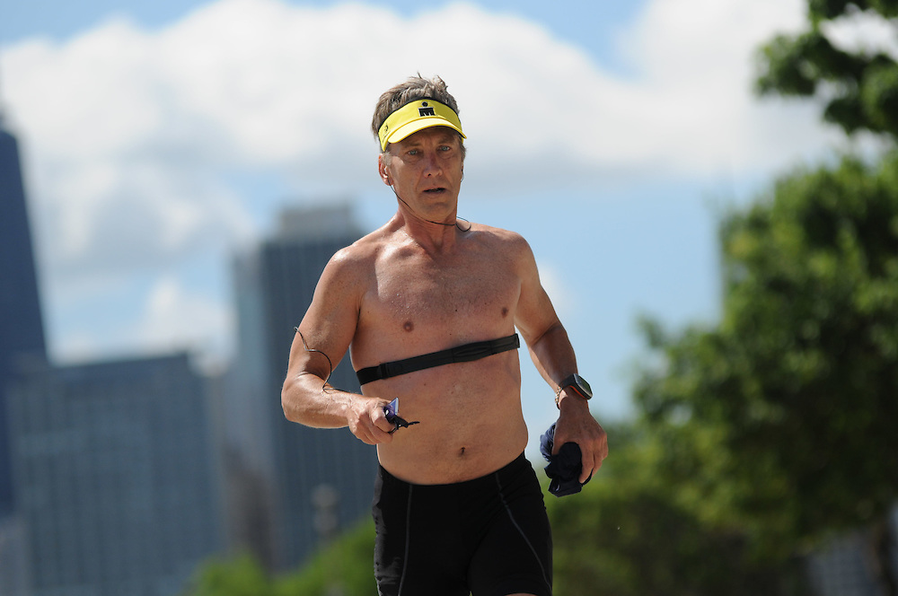 Chicago resident Ed Motto, 54 , is training on Chicago's lakefront for the upcoming Ford IronMan World Championship tri-athalon on October 9th in Hawaii. Motto swore that he'd never compete in such a grueling challenge of endurance again after finishing his first IronMan in 2008 in British Columbia. He finished the 2.4 mile swim followed by 112 miles of biking and then running a full 26.2 mile marathon in 12 hours. Then he did it again in 2009.