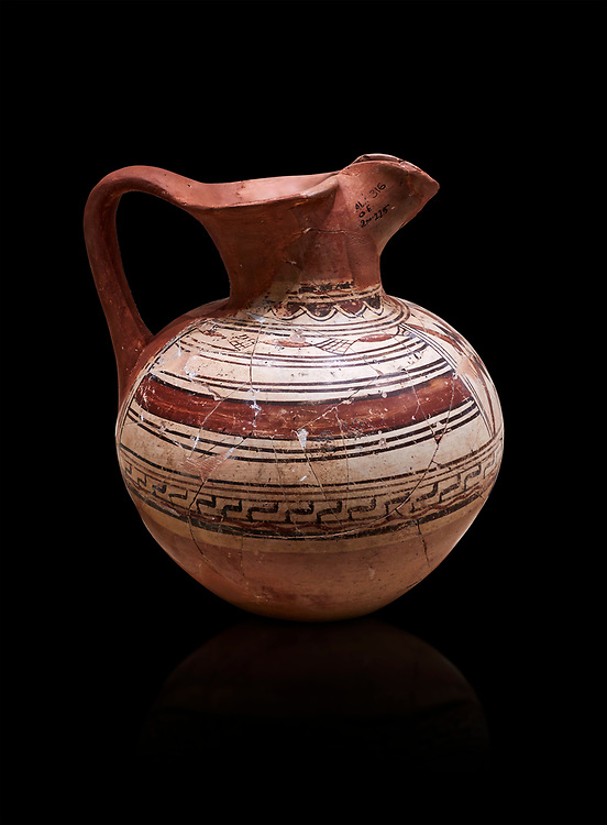 Phrygian terracotta trefoil jug decorated with geometric designs. 8th-7th century BC . Çorum Archaeological Museum, Corum, Turkey .<br /> <br /> If you prefer to buy from our ALAMY PHOTO LIBRARY  Collection visit : https://www.alamy.com/portfolio/paul-williams-funkystock/phrygian-antiquities.html (TIP - Refine search by adding a suject or background colour as well).<br /> <br /> Visit our CLASSICAL WORLD HISTORIC SITES PHOTO COLLECTIONS for more photos to download or buy as wall art prints https://funkystock.photoshelter.com/gallery-collection/Classical-Era-Historic-Sites-Archaeological-Sites-Pictures-Images/C0000g4bSGiDL9rw