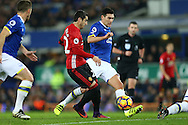 Henrikh Mkhitaryan of Manchester United is tackled by Gareth Barry of Everton who gives away a free kick. Premier league match, Everton v Manchester United at Goodison Park in Liverpool, Merseyside on Sunday 4th December 2016.<br /> pic by Chris Stading, Andrew Orchard sports photography.