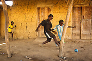 Boys play football in the village of Popoko, Bas-Sassandra region, Cote d'Ivoire on Tuesday March 6, 2012.
