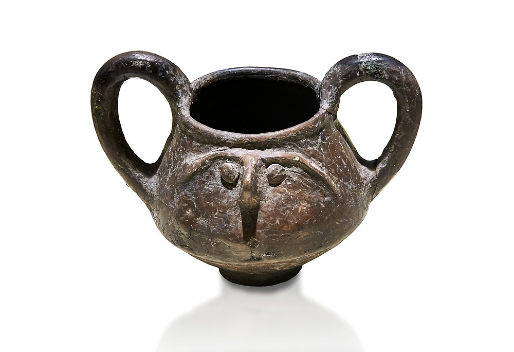 Hittite terra cotta double handled jug with a relief human face- 17th - 16th century BC - Hattusa ( Bogazkoy ) - Museum of Anatolian Civilisations, Ankara, Turkey . Against white background .<br />  <br /> If you prefer to buy from our ALAMY STOCK LIBRARY page at https://www.alamy.com/portfolio/paul-williams-funkystock/hittite-art-antiquities.html  - Type Hattusa into the LOWER SEARCH WITHIN GALLERY box. Refine search by adding background colour, place, museum etc<br /> <br /> Visit our HITTITE PHOTO COLLECTIONS for more photos to download or buy as wall art prints https://funkystock.photoshelter.com/gallery-collection/The-Hittites-Art-Artefacts-Antiquities-Historic-Sites-Pictures-Images-of/C0000NUBSMhSc3Oo