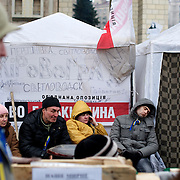 December 19, 2013 - Kiev, Ukraine: Pro-EU demonstrators take a rest in Independence Square.<br /> On the night of 21 November 2013, a wave of demonstrations and civil unrest began in Ukraine, when spontaneous protests erupted in the capital of Kiev as a response to the government's suspension of the preparations for signing an association and free trade agreement with the European Union. Anti-government protesters occupied Independence Square, also known as Maidan, demanding the resignation of President Viktor Yanukovych and accusing him of refusing the planned trade and political pact with the EU in favor of closer ties with Russia.<br /> After a days of demonstrations, an increasing number of people joined the protests. As a responses to a police crackdown on November 30, half a million people took the square. The protests are ongoing despite a heavy police presence in the city, regular sub-zero temperatures, and snow. (Paulo Nunes dos Santos/Polaris)