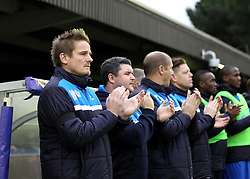 AFC Wimbledon Manager Neal Ardley and his coaching staff observe a minutes applause for ex-England Coach Don Howe - Mandatory byline: Robbie Stephenson/JMP - 07966 386802 - 26/12/2015 - FOOTBALL - Kingsmeadow Stadium - Wimbledon, England - AFC Wimbledon v Bristol Rovers - Sky Bet League Two