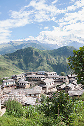 View of ghandruk village with mountain ranges in background