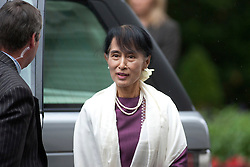 © Licensed to London News Pictures. 21/06/2012. LONDON, UK. Burmese Nobel peace prize winner and former political prisoner Aung San Suu Kyi arrives at Downing Street in London toda (21/0612). Aung San Suu Kyi, the leader of the Burmese opposition, today met with the British Prime Minister David Cameron as part of a trip to the UK. Photo credit: Matt Cetti-Roberts/LNP