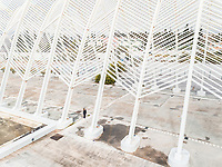 Aerial view of woman standing in metals structures in Olympic stadium in Athens