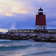 """""""Charlevoix Lighthouse"""" 2<br /> <br /> The beautiful red lighthouse in Charlevoix Michigan during a storm at sunset!!<br /> <br /> Lighthouses of the Great Lakes by Rachel Cohen"""