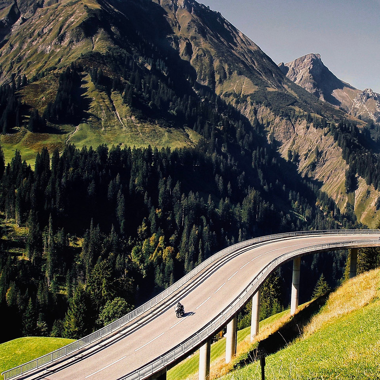 Motoring in the Alps is unsurpassed, whether on two wheels or four.  This rider negotiates an elevated road in Austria.