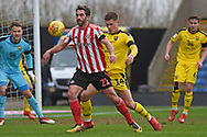 Sunderland forward Will Grigg (22) holds the ball up during the EFL Sky Bet League 1 match between Oxford United and Sunderland at the Kassam Stadium, Oxford, England on 9 February 2019.