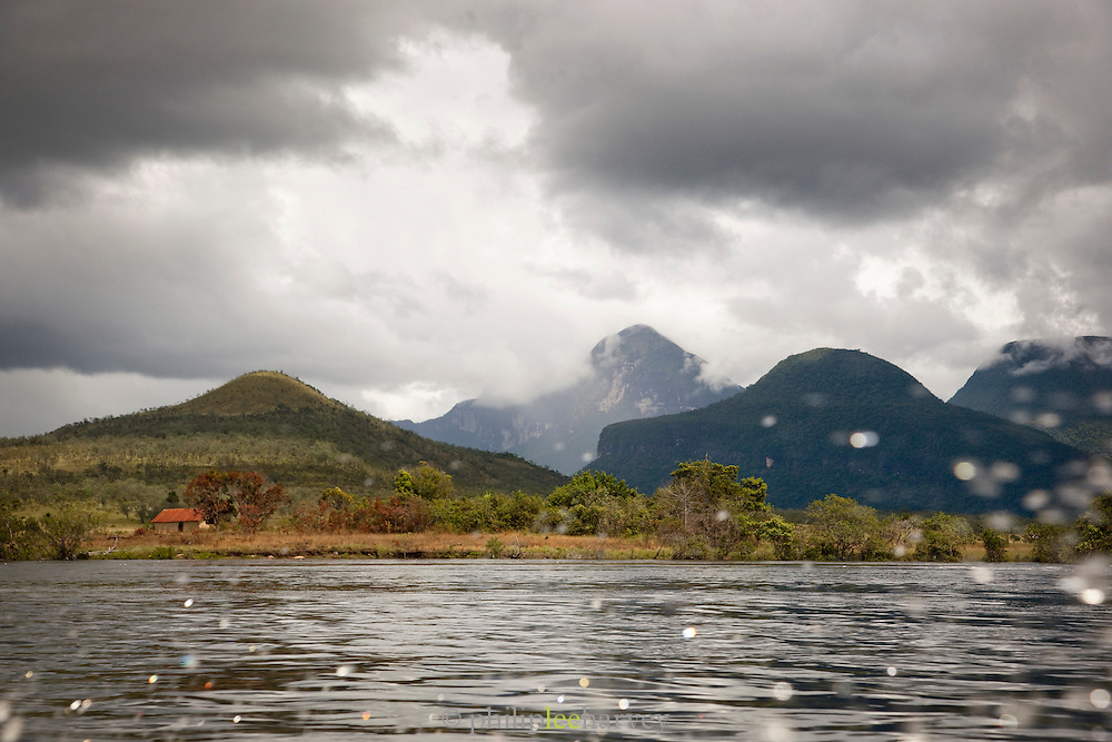 The mountainous landscape of Canaima National Park, seen from canoe while travelling towards Angel Falls on the Canaima River, Venezuela