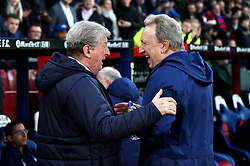Crystal Palace manager Roy Hodgson (left) and Cardiff City manager Neil Warnock (right) shake hands during the Premier League match at Selhurst Park, London.