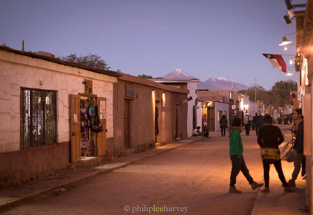 People at night on village street, San Pedro de Atacama, Atacama desert, Chile