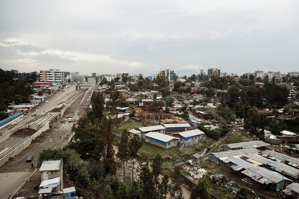 L'imponente cantiere stradale nell'area di Maganagna. Sullo sfondo alcuni dei nuovi edifici del quartiere 	Casancis, Addis Ababa 12 settembre 2014.  Christian Mantuano / OneShot <br /> <br /> The massive road construction site in the Maganagna area. In the background some of the new buildings in the Casanchis neighborhood. Addis Ababa September 12, 2014.