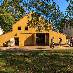 Lancaster, PA, USA - October 14, 2012: A large yellow barn at the Landis Valley Village & Farm Museum in Lancaster County, PA.