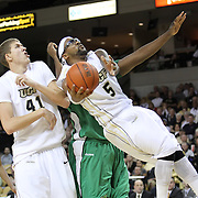 Central Florida guard Marcus Jordan (5) drives past Marshall center Orlando Allen (21) during a Conference USA NCAA basketball game between the Marshall Thundering Herd and the Central Florida Knights at the UCF Arena on January 5, 2011 in Orlando, Florida. Central Florida won the game 65-58 and extended their record to 14-0.  (AP Photo/Alex Menendez)