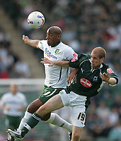 Photo: Lee Earle.<br /> Plymouth Argyle v Norwich City. Coca Cola Championship. 23/09/2006. Norwich's Dion Dublin (L) battles with Marcel Seip.