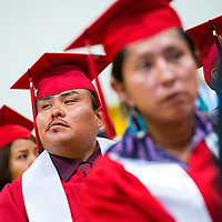 121213       Brian Leddy<br /> Navajo Technical University Clifford Keams looks around the room during graduation ceremonies in Chinle Friday. The graduation was the first for the school as a university.