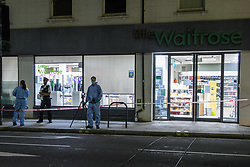 © Licensed to London News Pictures. 26/08/2021. London, UK. Forensic investigators and a police officer at a Little Waitrose store on Fulham Palace Road following the arrest of a man on suspicion of contamination of goods with intention of causing public harm or anxiety after foodstuffs at supermarkets were injected with needles. Metropolitan Police were called at approximately 19:40BST on Wednesday 25/08/2021 after a man was reported to be shouting abuse at people in the street. The man is reported to have gone into three supermarkets in Fulham Palace Road and injected foodstuffs with a number of needles. Photo credit: Peter Manning/LNP
