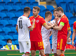 CARDIFF, WALES - Saturday, June 5, 2021: Wales' Aaron Ramsey and Albania's Rey Manan clash during an International Friendly between Wales and Albania at the Cardiff City Stadium in their game before the UEFA Euro 2020 tournament. (Pic by David Rawcliffe/Propaganda)