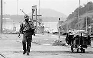 Panama Canal Commission employee walking at the Miraflores Locks.