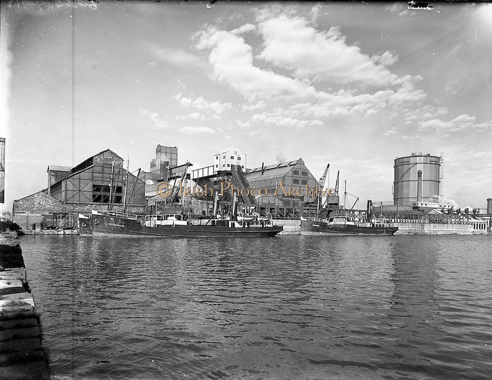"""12/03/1957<br /> 03/12/1957<br /> 12 March 1957<br /> Exterior of Dublin Gas Company, Grand Canal Quay, Dublin. Three of the company ships can be seen including """"Glencullen"""" and """"Glencree""""."""