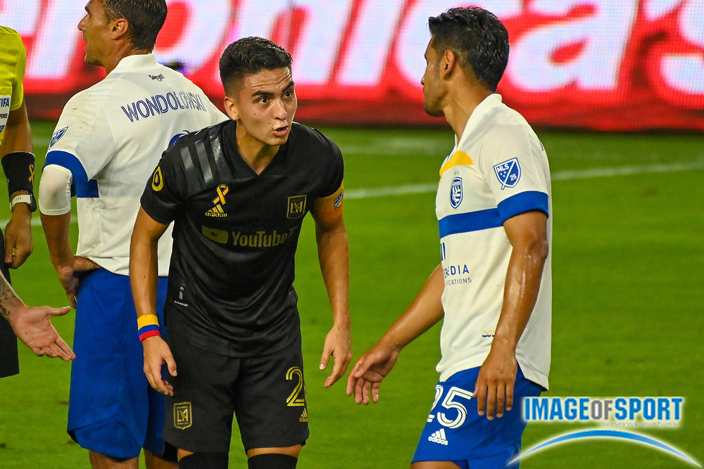 LAFC midfielder Eduard Atuesta (20) reacts to San Jose Earthquakes forward Andres Rios (25) during a MLS soccer game, Sunday, Sept. 27, 2020, in Los Angeles. The San Jose Earthquakes defeated LAFC 2-1.(Dylan Stewart/Image of Sport)