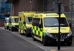 © Licensed to London News Pictures. 29/12/2020. London, UK. A line of ambulances waits out The Royal London Hospital. A record of 41,385 cases of Covid-19 infections was reported on Monday and the number of people being treated for the virus in hospital has now reached 20,426, which is greater that the previous peak of about 19,000 in April. Photo credit: Peter Macdiarmid/LNP