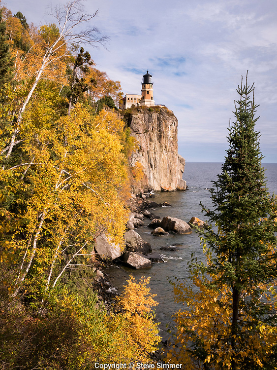 The lighthouse offers a different personality every day. Fall colors under light clouds were this day's gift.