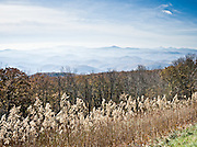 See the Blue Ridge Mountains and Wilson Creek Valley (2400 feet elevation), Pisgah National Forest, at Blue Ridge Parkway Milepost 302.0 at elevation 4356 feet, North Carolina, USA. Wilson Creek is one of the streams originating on Grandfather Mountain. Stitched from 2 overlapping photos.