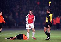 Martin Keown is show the yellow card by referee Erik Fisker. Shakhtar Donetsk 3:0 Arsenal, UEFA Champions League, Group B, Centralny Stadium, Donetsk, Ukraine, 7/11/2000. Credit Colorsport / Stuart MacFarlane.