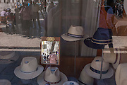 Hats on sale in the window of Chapelaria Azevedo Rua on Rossio Praca Dom Pedro IV, in Lisbon, Portugal.