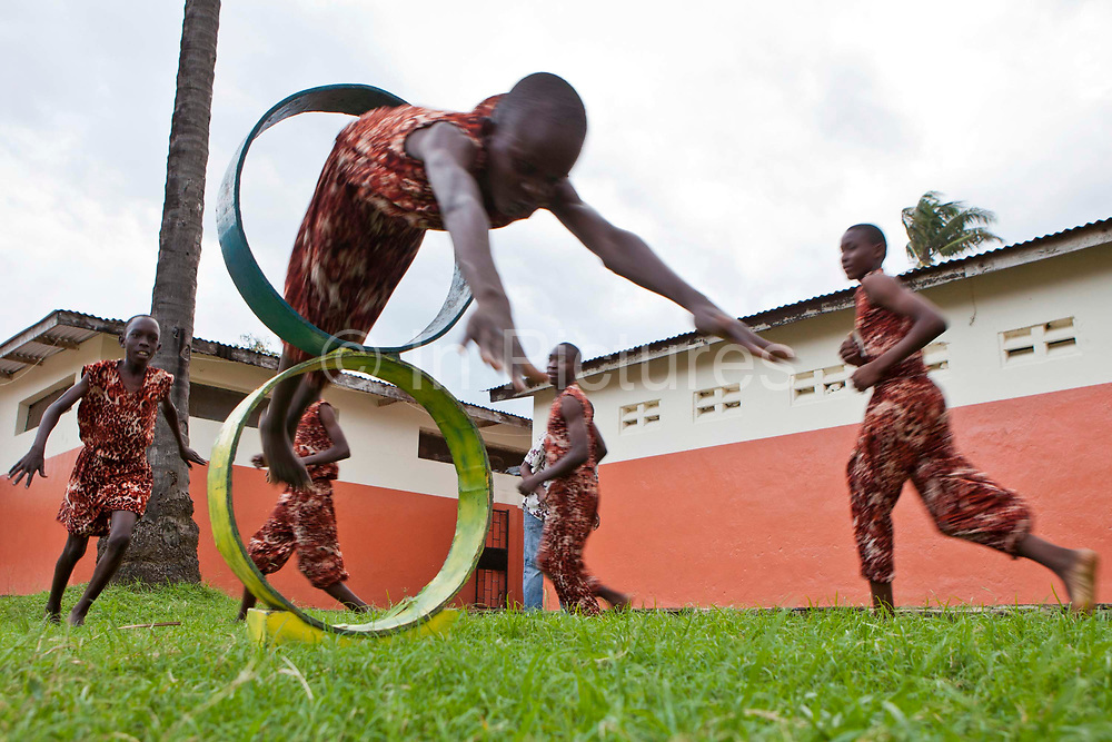Boys at the Wema centre in Mombassa practice and perform acrobatics as part of their rehabilitation program. Wema is a NGO organisation in Kenya that provides rehabilitation programs for street children; poor, disadvantaged youth; and, orphaned and vulnerable children affected by poverty. Emotional support and education enables the children reintegration back into society.