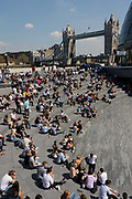 Crowds of office workers and tourists at lunchtime sit in the Scoop on the South Bank seen in front of Tower Bridge during hot and sunny weather on April 20, 2018 in London, England. Yesterday the United Kingdom experienced the hottest day in April since 1949, with temperatures reaching 27.9C 82.2F in London.