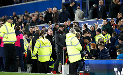 Liverpool manager Jurgen Klopp speaks to the ball boy after the final whistle