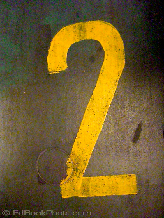 numeral two painted on a weathered surface