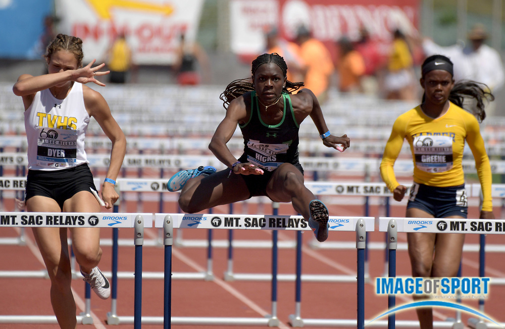 Apr 21, 2018; Torrance, CA, USA; Jada Hicks of Upland (center) wins the invitational girls 100m hurdles in 13.54 during the 60th Mt. San Antonio College Relays at Murdock Stadium.