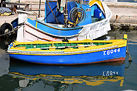 Fishing, dinghy moored at the quayside in Marsaxlokk