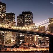 Manhattan with the Brooklyn Bridge after sunset on Halloween night, 2008.