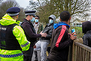 Police officers in discussions with Asylum seekers outside Napier Barracks after intelligence was received that there could be a protest outside the barracks with banners and signs got out to demonstrate about the poor conditions they are subjected to inside the holding centre on the 12th of January 2021, Folkestone Kent. Police spent all day outside the holding centre in Folkestone where over 400 asylum seekers are being kept at Napier Barracks in unsuitable, cold accommodation, they are experiencing mental health issues as well as being vulnerable to health conditions including COVID-19.  (photo by Andy Aitchison)