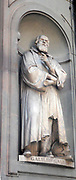 Statue located outside of the Uffizi museum in Florence, Italy. One of the oldest art museums in the Western World. Semi enclosed figurative statues such as this appear all over Florence. Statue of Galileo Galilei, Italian physicist, mathematician, astronomer, and philosopher
