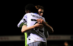 Josh Davison of Forest Green Rovers hugs Brendan Sarpong-Wiredu of Colchester United at the final whistle- Mandatory by-line: Nizaam Jones/JMP - 27/02/2021 - FOOTBALL - The innocent New Lawn Stadium - Nailsworth, England - Forest Green Rovers v Colchester United - Sky Bet League Two