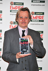 © under license to London News Pictures. 27/03/11. Gary Oldman on the Winners Boards at the Jamesons Empire Film Awards, 27th March 2011 at the Grosvenor House Hotel, London. Colin Firth won Best Actor and presented the Empire Icon prize to Gary Oldman. Photo credit should read Alan Roxborough/LNP