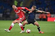 Matthew Connolly of Cardiff city (l) holds off Adam Clayton of Middlesbrough (r).  Skybet football league championship match, Cardiff city v Middlesbrough at the Cardiff city stadium in Cardiff, South Wales on Tuesday 16th Sept 2014<br /> pic by Andrew Orchard, Andrew Orchard sports photography.